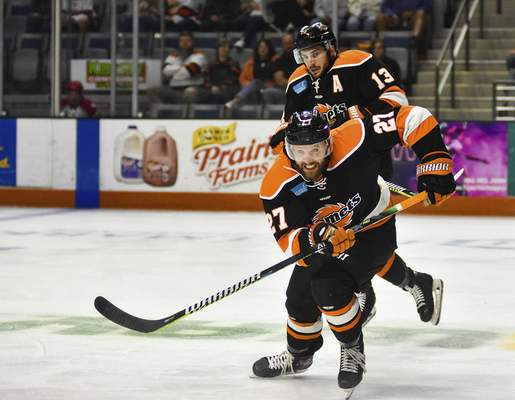 Katie Fyfe | The Journal Gazette  Komets forward Shawn Szydlowski chases the puck during the first period against the Allen Americans at Memorial Coliseum on Monday.