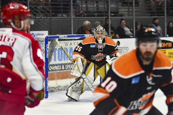 Katie Fyfe | The Journal Gazette  Komets goalie Dylan Ferguson keeps his eye on the puck during the first period against the Allen Americans at Memorial Coliseum on Monday.