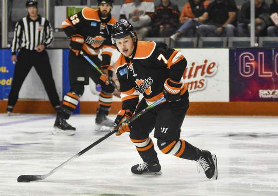 Katie Fyfe | The Journal Gazette  Komets forward Brandon Hawkins carries the puck during the first period against the Allen Americans at Memorial Coliseum on Monday.
