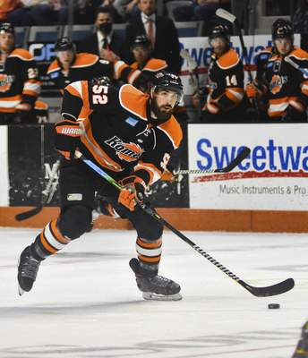 Katie Fyfe | The Journal Gazette  Komets defenseman Mathieu Brodeur looks to make a pass during the first period against the Allen Americans at Memorial Coliseum on Monday.