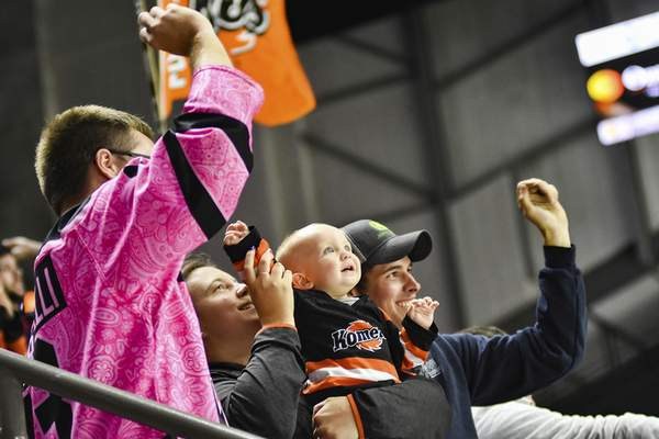 Katie Fyfe | The Journal Gazette  Fans cheer after Komets score a goal during the first period against the Allen Americans at Memorial Coliseum on Monday.