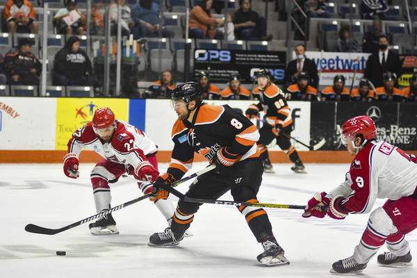 Katie Fyfe | The Journal Gazette  Komets defenseman Blake Siebenaler carries the puck during the second period against the Allen Americans at Memorial Coliseum on Monday.