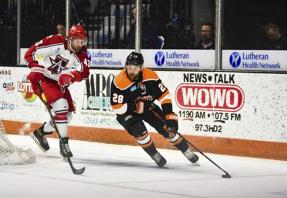 Katie Fyfe | The Journal Gazette  Komets forward Matthew Boudens brings the puck around the goal during the first period against the Allen Americans at Memorial Coliseum on Monday.
