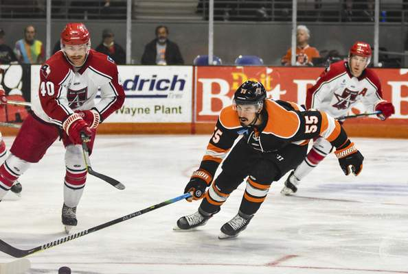 Katie Fyfe | The Journal Gazette  Komets forward Jackson Leef chases the puck during the second period against the Allen Americans at Memorial Coliseum on Monday.