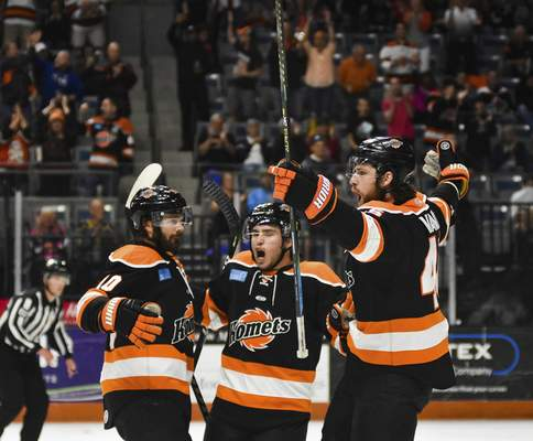 Katie Fyfe | The Journal Gazette  Komets players celebrate after scoring a goal against the Allen Americans during the first period at Memorial Coliseum on Monday.