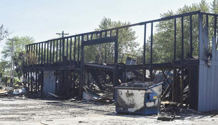 Michelle Davies | The Journal Gazette  A shell is all that remains of a warehouse on Line Street in Columbia City after an explosion on Saturday, May 22, 2021 that left one person dead.