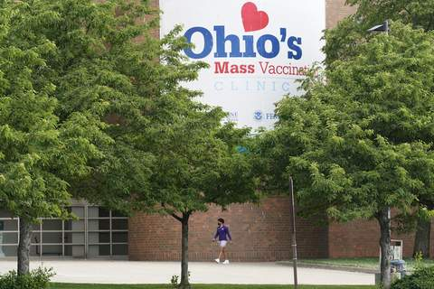 Virus Outbreak Vaccine Incentive FILE - In this May 25, 2021, file photo, a man walks by the entrance for Ohio's COVID-19 mass vaccination clinic at Cleveland State University in Cleveland. (AP Photo/Tony Dejak, File) (Tony Dejak STF)