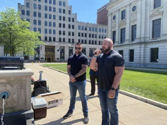 Jamie Duffy   The Journal Gazette  Nate Moellering, at the mic, speaks at an Association of People Against Lethal Drugs rally earlier this month. He and his business partner, Tommy Streeter, run Bare Knuckle Recovery in Fort Wayne.