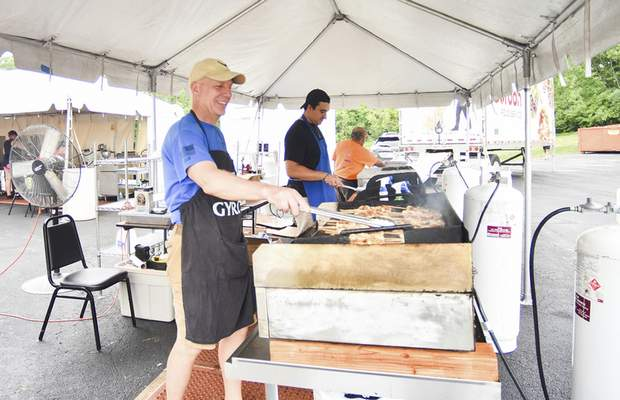 Photos by Katie Fyfe | The Journal Gazette Eddie York, George Rongos and George Gogos make food during the annual Greek Fest on Saturday at Holy Trinity Greek Orthodox Church on East Wallen Road.