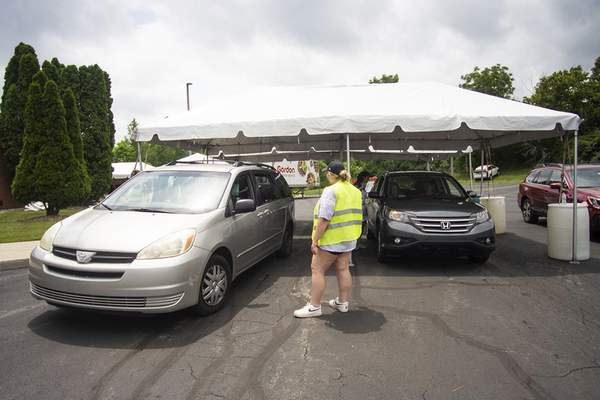 Katie Fyfe | The Journal Gazette  Cars line up for food during Greek Fest at Holy Trinity Greek Orthodox Church on Saturday.