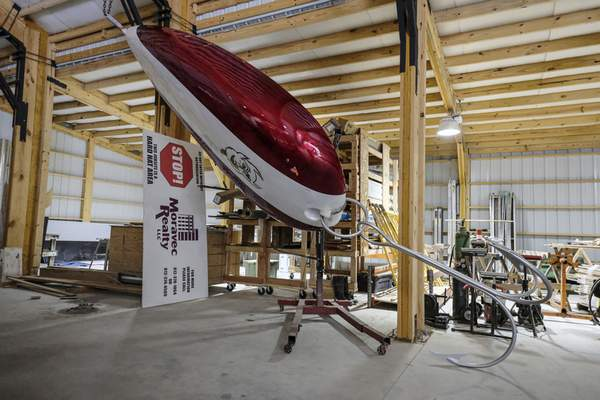 A view of a giant, artistic replica of an old fishing lure created by artist Bobbie K Owens at his studio west of Columbus, Ind., Wednesday, June 16, 2021. The fishing lure will be installed at Upland in Columbus, Ind. (Mike Wolanin/The Republic via AP)