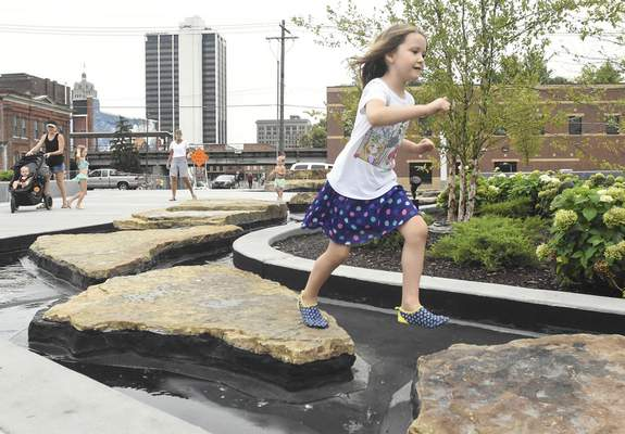 Promenade Park, the city's newest greenspace, offers several things for children to do, including leaping across the stones in the Doermer Kids' Canal.