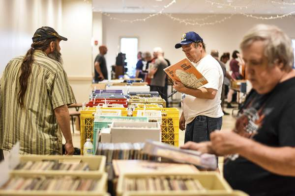 Photos by Katie Fyfe   The Journal Gazette People look through vinyl records Sunday at the Fort Wayne Hobby and Collectibles Show.