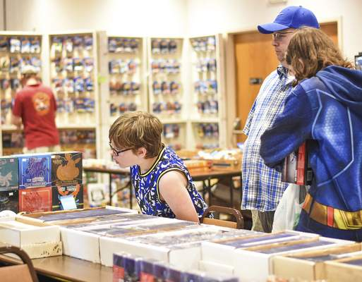 Connor Cashore, 8, checks out items during the event at Classic Cafe Catering & Event Center.