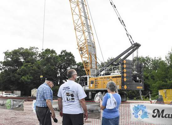 Michelle Davies | The Journal Gazette Foster Parkway neighbors, from left, Bill Gerig, Brian Schwartz and Kay Schwartz gather Wednesday at Foster Park, the end point of a nearly 5-mile-long sewer tunnel that was recently completed.