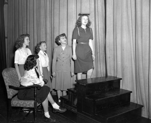 March 6, 1948:Carolyn McCray balances a book on her head while climbing stairs in a demonstration on correct posture at the all-day 4-H Charm School at Purdue University Center. Watching are, from left, Mariellen Gerig, Frances Smith, Arden Slough and Carol Schieferstein. (Journal Gazette file photo)