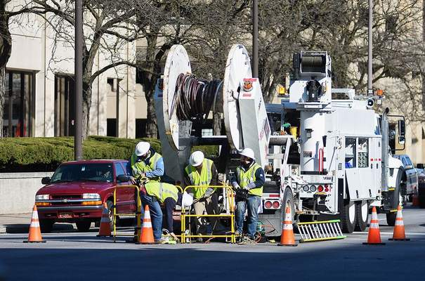 FILEIndiana Michigan Power employees work at Clinton and Main streets in April.