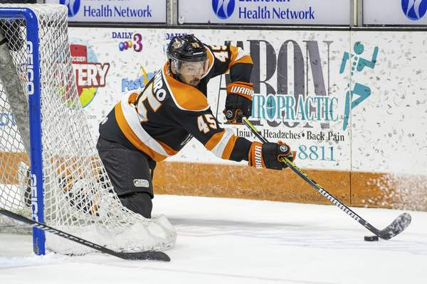 Josh Gales  Special to The Journal Gazette  The Komets' Zach Pochiro looks to make a play Friday during Game 4 of the Kelly Cup Finals at Memorial Coliseum.