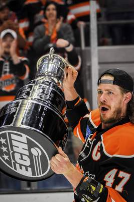 Mike Moore | The Journal Gazette Komets team captain A.J. Jenks holds up the Kelly Cup Championship trophy in front of a sold out crowd at Memorial Coliseum on Friday.