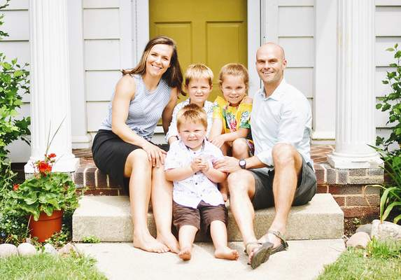 Katie Fyfe | The Journal Gazette Former Peace Corps volunteer Sam Ladowski is pictured outside his Fort Wayne home with his family last month.