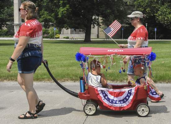 Photos by Michelle Davies | The Journal Gazette Taking part in Woodhurst's traditional parade Sunday are family members, from left, Kaitlin Frecker, Teddy Frecker, 3, Maggie Frecker, 1, and Beth Krudop, grandmother, who lives in the neighborhood.