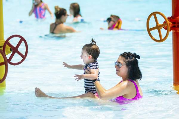 Photos by Katie Fyfe   The Journal Gazette Nicole Arnett enjoys the water with 19-month-old daughter Ella Arnett at Northside  Pool on Monday.