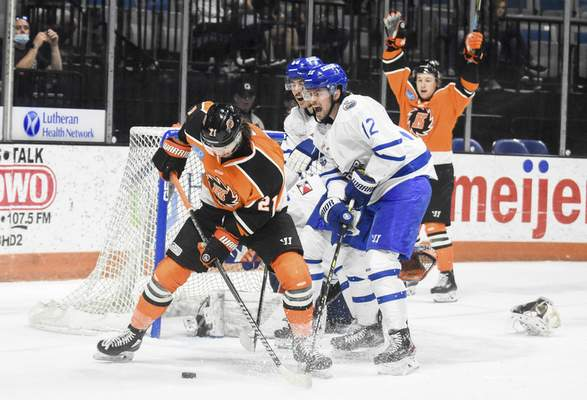 Michelle Davies | The Journal Gazette  The Komets' Marco Roy, left, fights for control of the puck with Wichita's Cam Clarke on May 23 at Memorial Coliseum.