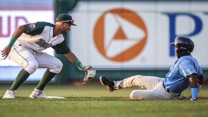Mike Moore | The Journal Gazette TinCaps shortstop Justin Lopez reaches for the tag as Captains' designated hitter Victor Nova slides into second base at Parkview Field on Tuesday.