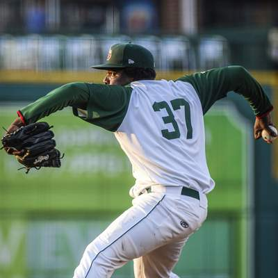 Mike Moore | The Journal Gazette TinCaps pitcher Moises Lugo delivers to home against Lake County on Tuesday.