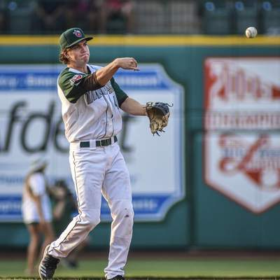 Mike Moore | The Journal Gazette TinCaps third baseman Chris Givin warms up between innings at Parkview Field on Tuesday.