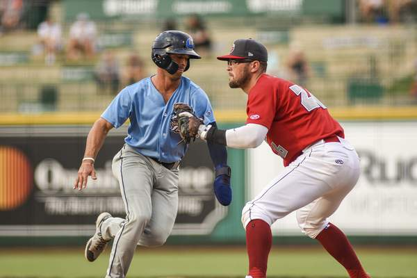 Mike Moore   The Journal Gazette TinCaps first baseman Seamus Curran readies for a throw as a Lake County runner heads back to the bag in the second inning of Wednesday night's game at Parkview Field.