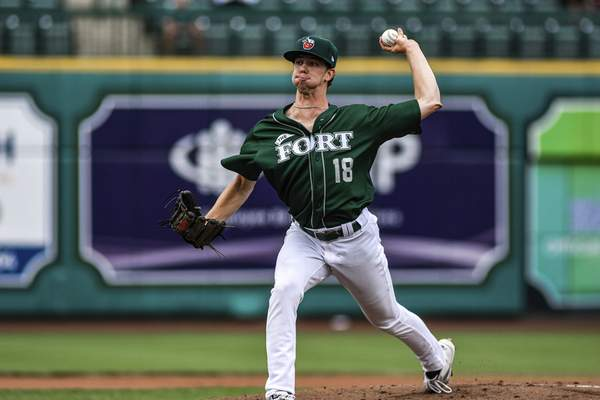 Mike Moore   The Journal Gazette TinCaps pitcher Ethan Elliott winds up before the pitch in the first inning against Lake County on Thursday.