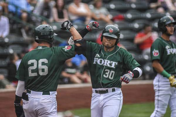 Mike Moore   The Journal Gazette TinCaps right fielder Tirso Ornelas,right, celebrates with teammate Seamus Curran after hitting a homerun in the first inning against Lake County at Parkview Field on Thursday.
