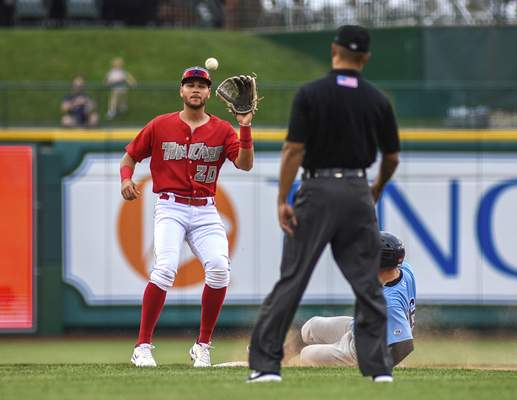 Mike Moore   The Journal Gazette TinCaps shortstop Justin Lopez catches a throw from home in the second inning against Lake County at Parkview Field on Wednesday.