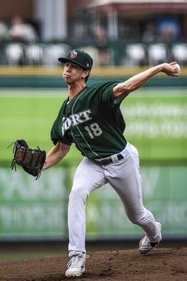 Mike Moore | The Journal Gazette TinCaps pitcher Ethan Elliott winds up before the pitch in the first inning against Lake County on Thursday.