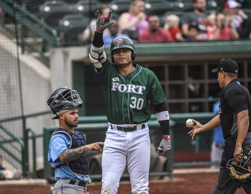 Mike Moore | The Journal Gazette TinCaps right fielder Tirso Ornelas waves at fans after hitting a home run Thursday night at Parkview Field.