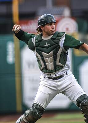 Mike Moore   The Journal Gazette TinCaps catcher Adam Kerner throws to first base for an out in the first inning against Lake County at Parkview Field on Friday.