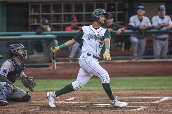 Mike Moore | The Journal Gazette TinCaps second baseman Justin Lopez at bat in the first inning against Lake County at Parkview Field on Friday.
