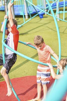 Katie Fyfe   The Journal Gazette  Jon Evans, 7, Dalton Fagnant, 6, and Moira Colglazier, 6, play together at Taylor's Dream Boundless Playground in Kreager Park on Wednesday.
