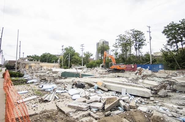 Katie Fyfe   The Journal Gazette  The Rescue Mission on Superior Street was torn down Thursday.