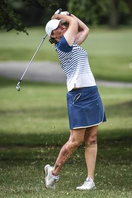 Mike Moore   The Journal Gazette Michelle Smith playing in the first round of the Women's City Golf Tournament at Coyote Creek on Friday.