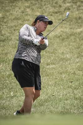 Mike Moore | The Journal Gazette Lori Stinson playing in the first round of the Women's City Golf Tournament at Coyote Creek on Friday.