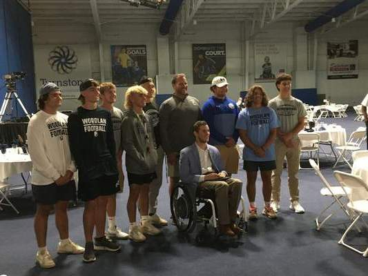 Dylan Sinn | The Journal Gazette  Members of the Woodlan football team and coach Mike Smith pose with motivational speaker Chris Norton, who spoke at Turnstone's Start Strong: Limitless Possibilities breakfast.