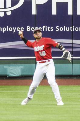 Katie Fyfe | The Journal Gazette  The TinCaps' Tirso Ornelas tros the ball tothe infield during the fourth inning against theLake CountyCaptains at Parkview Field on Saturday.