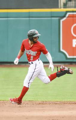 Katie Fyfe | The Journal Gazette  The TinCaps' Reinaldo Ilarraza slides back onto second base during the third inning against theLake CountyCaptains at Parkview Field on Saturday.