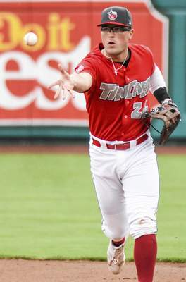 Katie Fyfe | The Journal Gazette  The TinCaps' Seamus Curran tosses the ball during the fourth inning against theLake CountyCaptains at Parkview Field on Saturday.