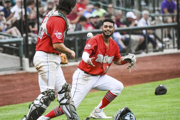 Katie Fyfe | The Journal Gazette  The TinCaps' Kelvin Alarcon throws the ball to Jonny Homza at first base during the fourth inning against theLake CountyCaptains at Parkview Field on Saturday.