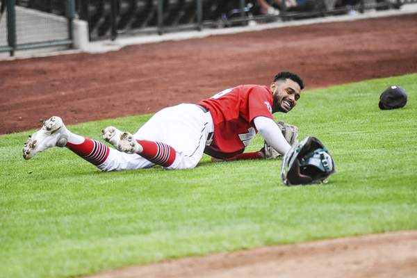 Katie Fyfe | The Journal Gazette  The TinCaps' Kelvin Alarcon dives to catch the ball during the fourth inning against theLake CountyCaptains at Parkview Field on Saturday.
