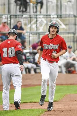 Katie Fyfe | The Journal Gazette  The TinCaps' Chris Givin hits a home run during the third inning against theLake CountyCaptains at Parkview Field on Saturday.
