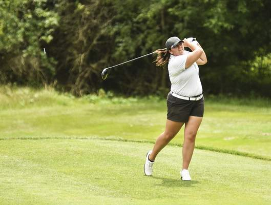 Katie Fyfe | The Journal Gazette  Alexis Stuckey tees off on the 6th hole during the second round of Women's City Golf Tournament at Coyote Creek Golf Course on Saturday.